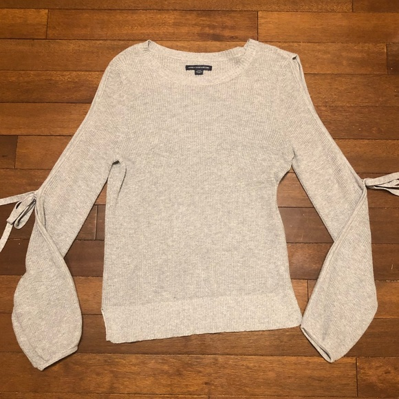 Grey American Eagle sweater with ties on arms